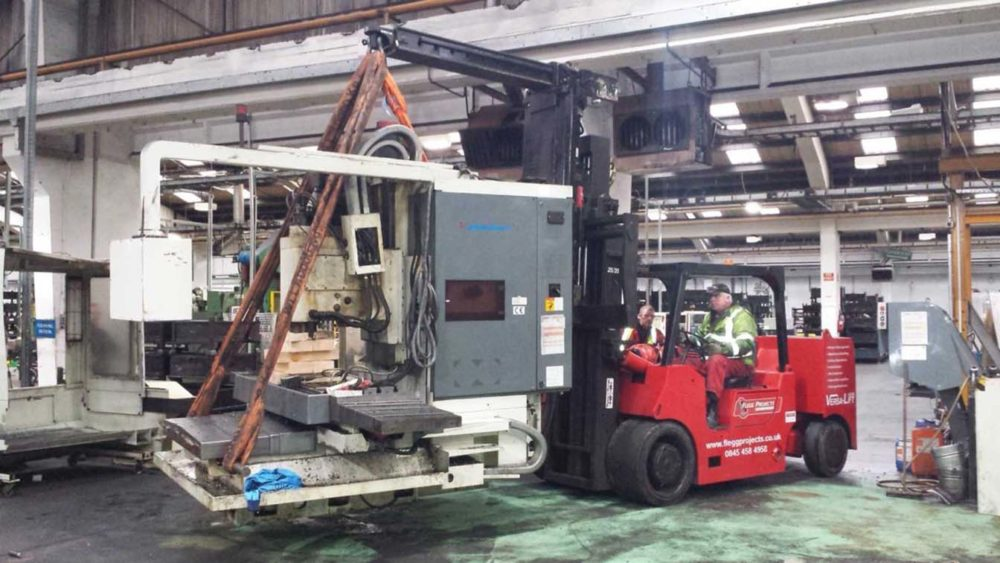 forklift moving customer machinery