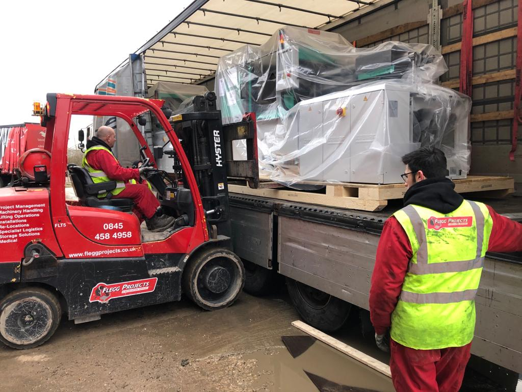 Unloading machines into the warehouse