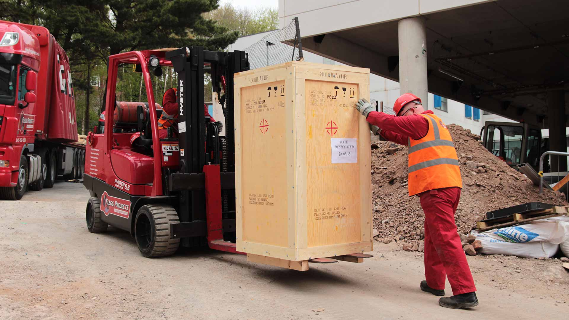 forklift carrying a crate
