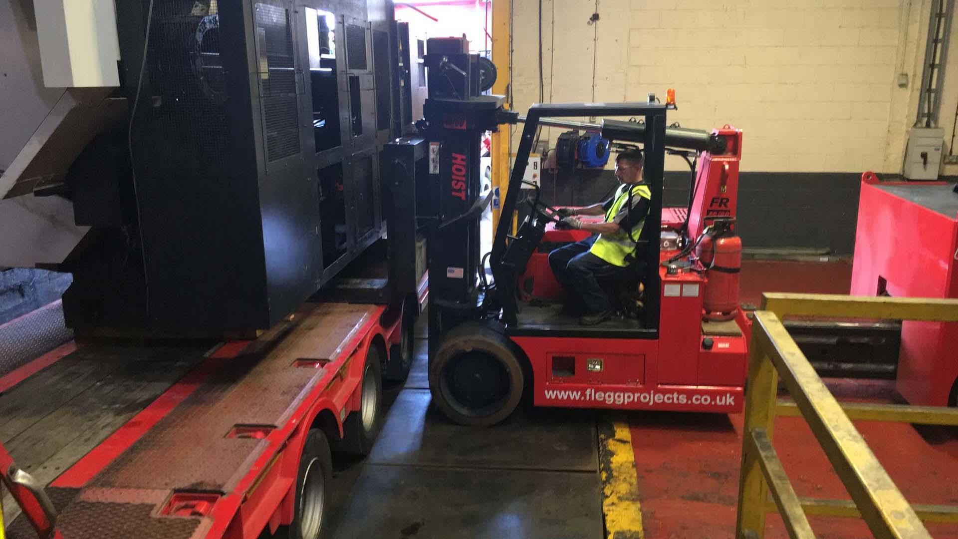 operator lifting machine onto a lorry