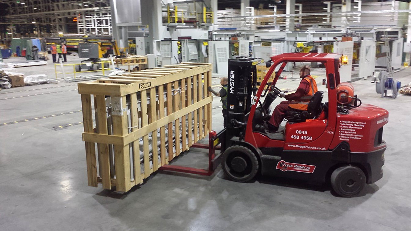 Forklift moving crate
