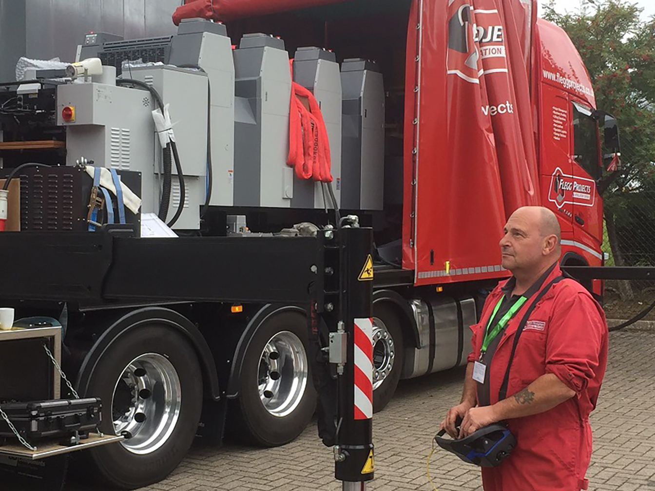 Operator moving equipment from lorry