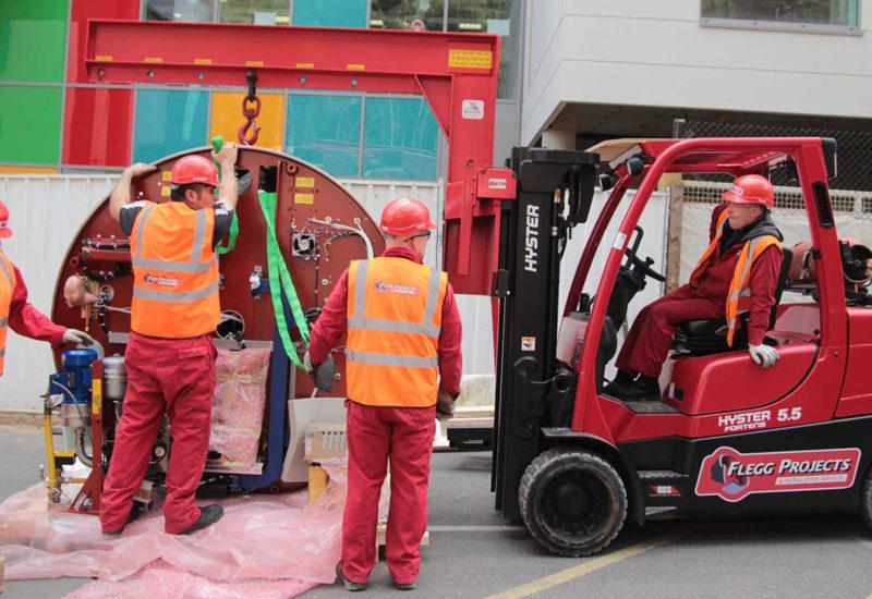 Team moving medical equipment
