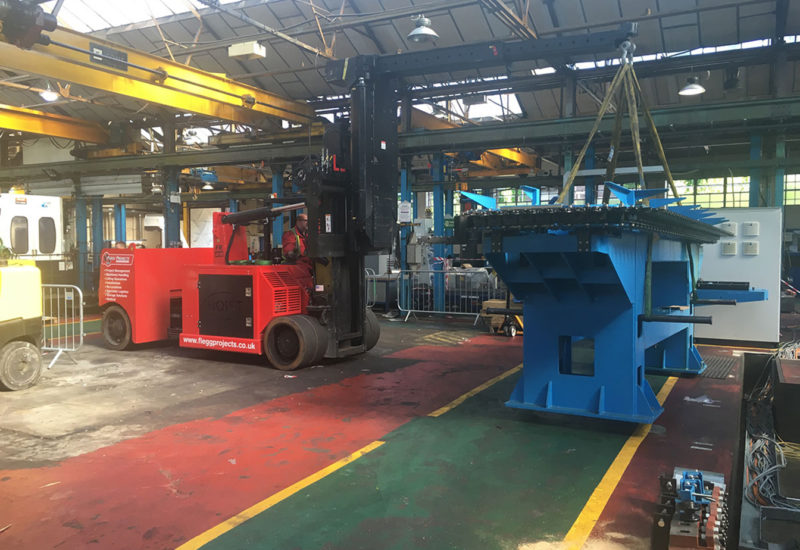 forklift moving equipment in factory
