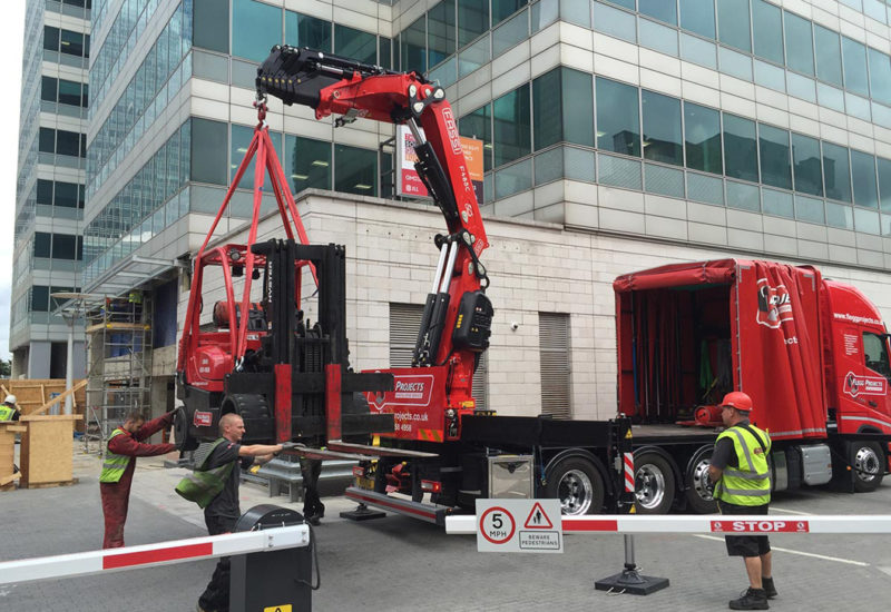 Forklift being craned from a lorry
